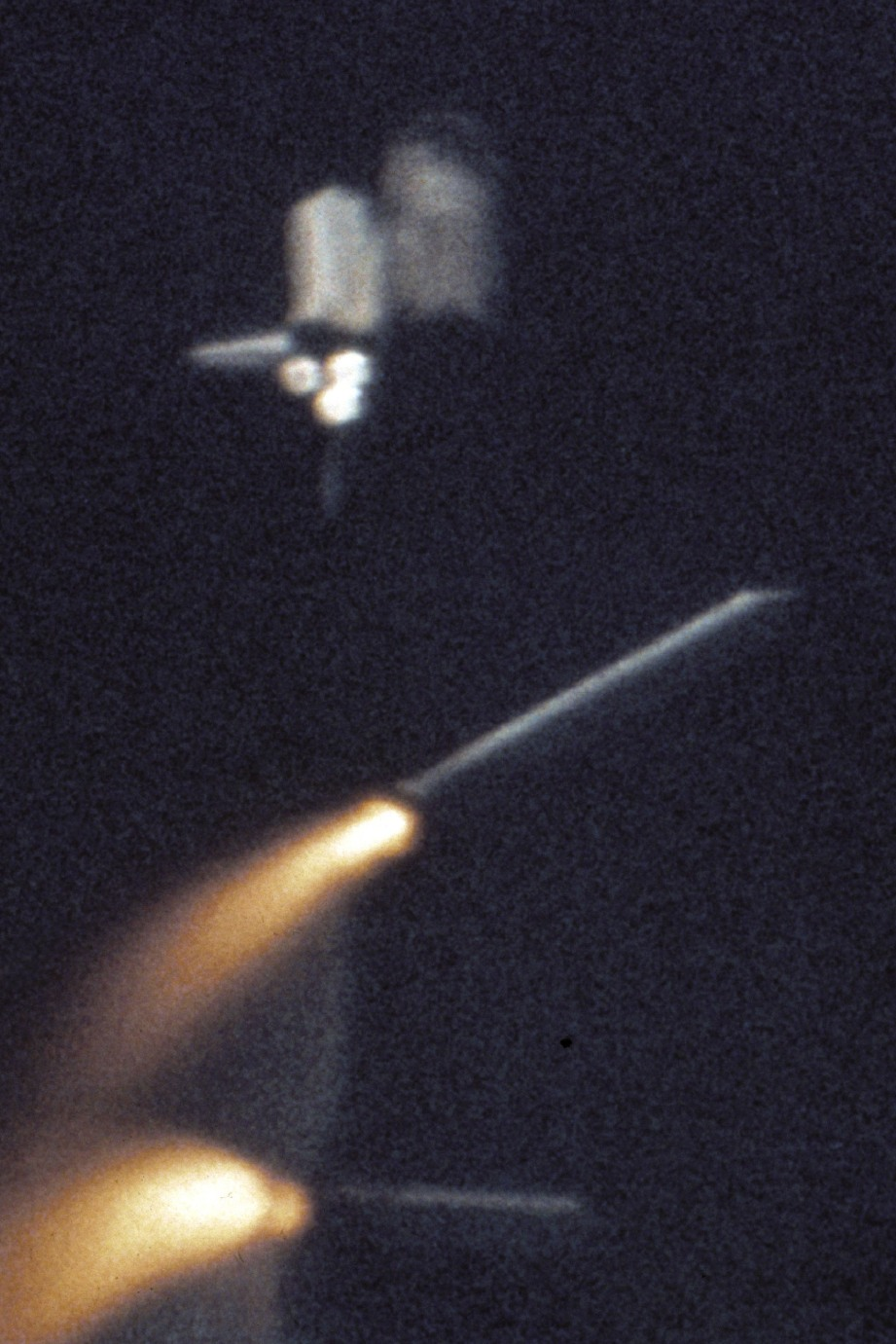 The Shuttle's Solid Rocket Boosters break away and fall to Earth about two minutes after liftoff.