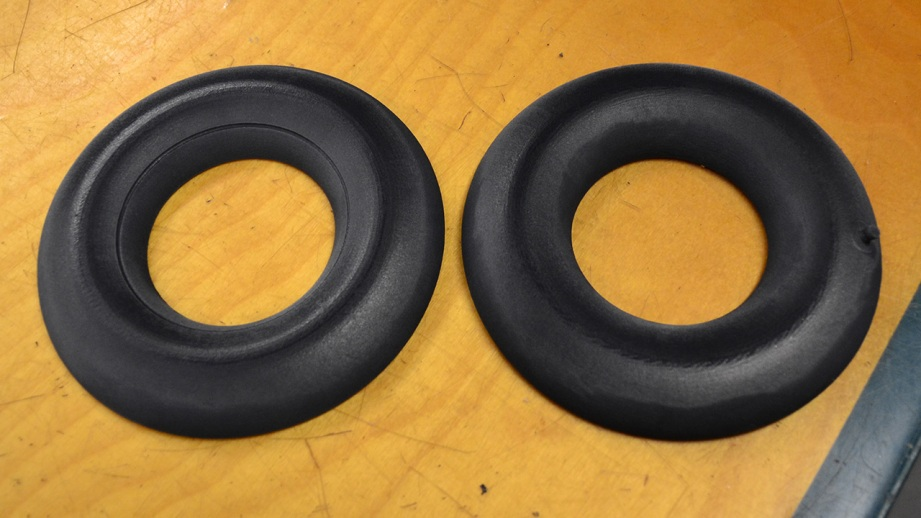Two halves of an inner tube model about the size of a bagel. By mixing rubber and black plastic the end result feels like a real inner tube.