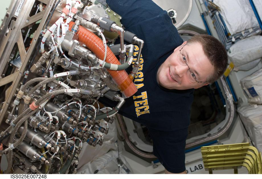 The Sabatier reactor on the ISS, seen here with Doug Wheelock, combines two unwanted gases (hydrogen and carbon dioxide) to produce water for the crew.