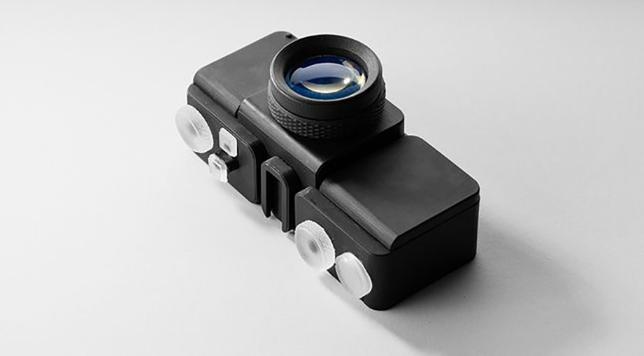 Polished 3D printed lens and camera - CREDIT: Amos Dudley
