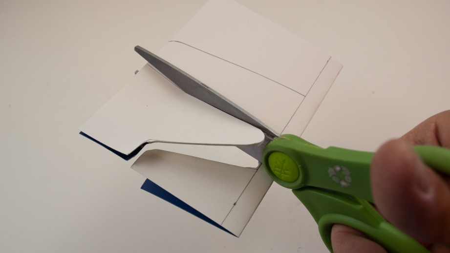 Be careful to avoid creasing the airplane as you cut out the profile with scissors.