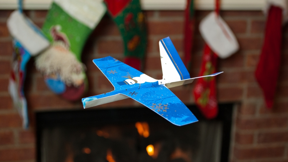 A properly trimmed Christmas card airplane should easily cruise across your living room.